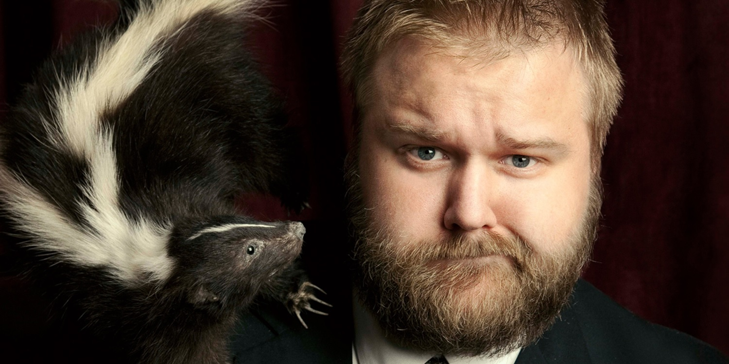 Robert Kirkman with skunk
