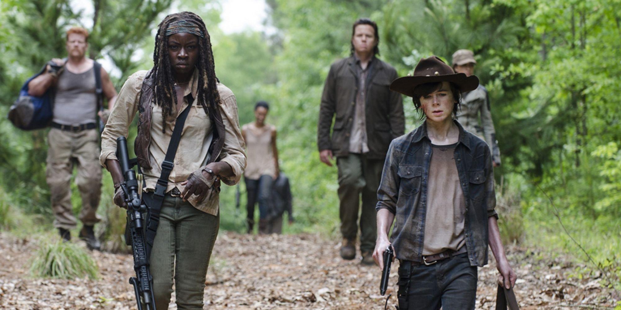 Michael Cudlitz as Abraham, Danai Gurira as Michonne, Josh McDermitt as Eugene and Chandler Riggs as Carl in The Walking Dead