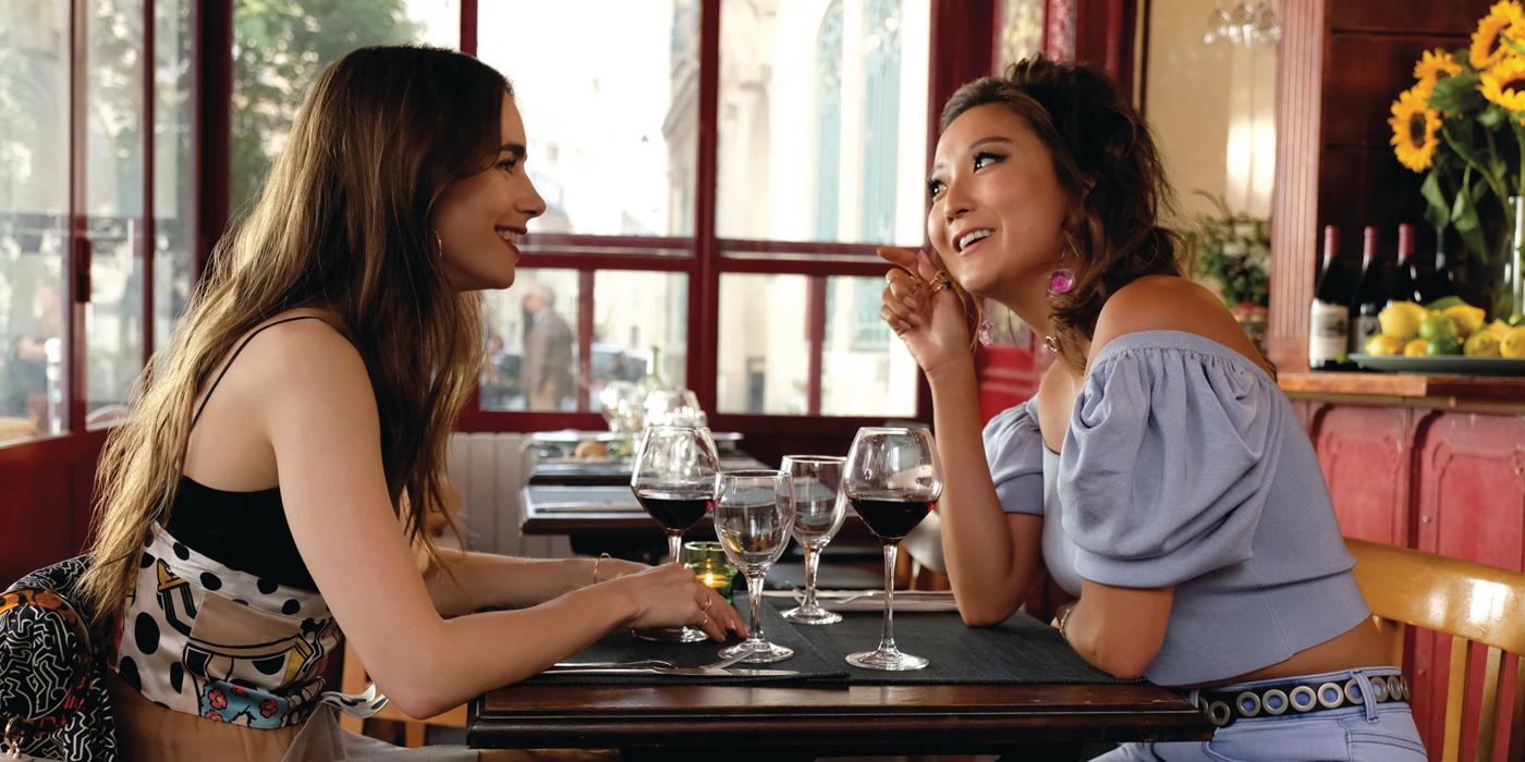 Ashley Park talking to Emily in Paris.