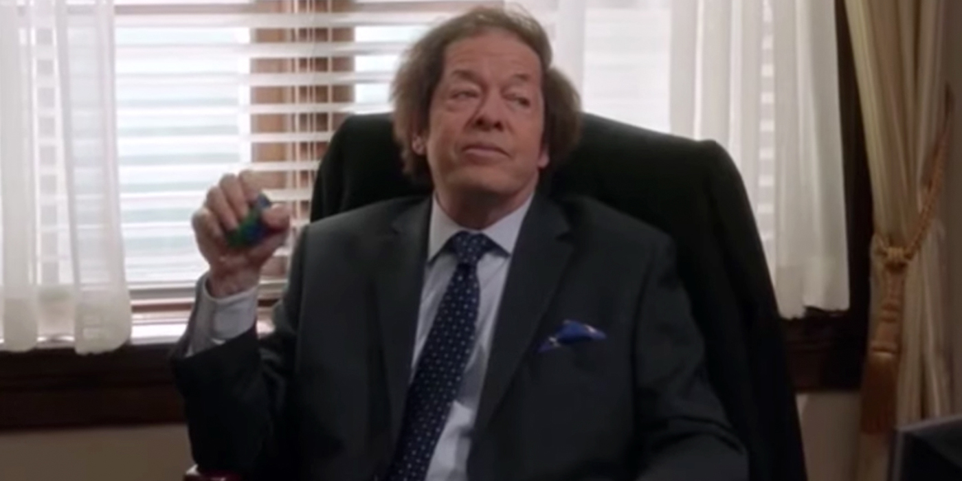 Jonathan Hadary sitting at a desk in Veep.