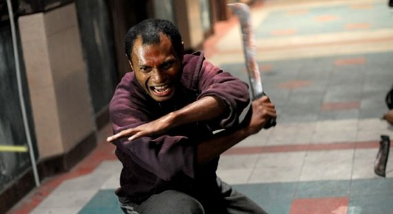 Alfridus Godfred as Machete Gang Leader in The Raid Redemption The Raid: Redemption Director on Action Movie Innovation & Machete Mishaps