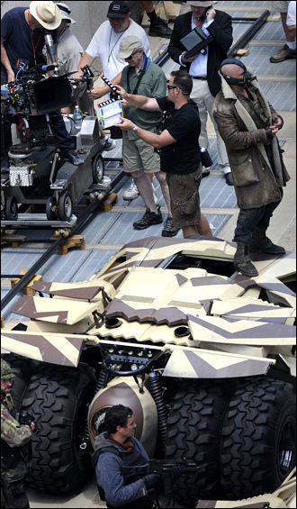 Bane on Camo Tumbler Banes Full Costume Revealed in Dark Knight Rises Set Images