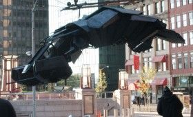 Batwing Hovering Over Banes Earthquake Device 280x170 Dark Knight Rises On Wall Street; Batwing Soars & A Mystery Device