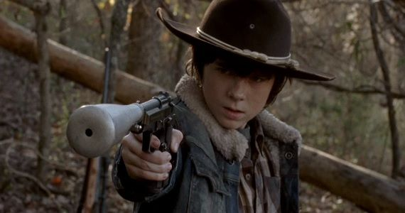 Carl Grimes with a gun in The Walking Dead The Walking Dead Season 4 Clip: Carl Rushes to Michonnes Rescue