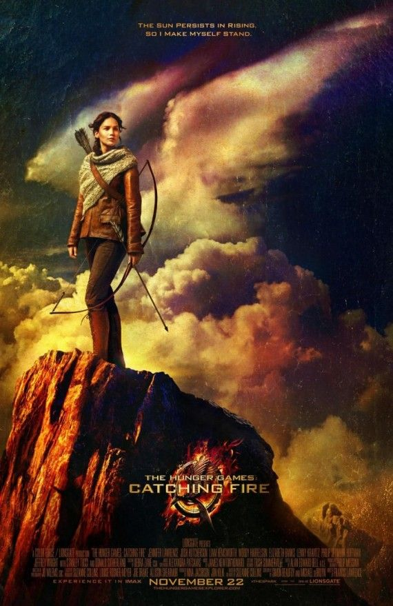 Catching Fire poster 570x879 New Hunger Games: Catching Fire Poster Shows Katniss Standing Tall