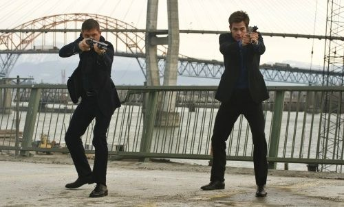 Tom Hardy and Chris Pine taking aim in 'This Means War'