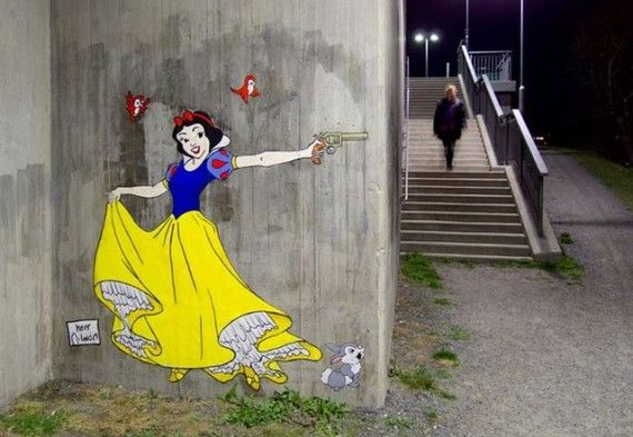 Disney Princesses Wielding Knives and Guns in Stockholm Street Art 570x393 SR Geek Picks: Red Dead Redemption Film, Man of Steel/Star Trek Mashup, Game of Thrones LEGOs & More
