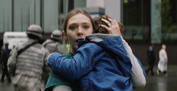 Elizabeth Olsen and Carson Bolde in Godzilla Godzilla Interview: Elizabeth Olsen Talks About Her First CGI Experience