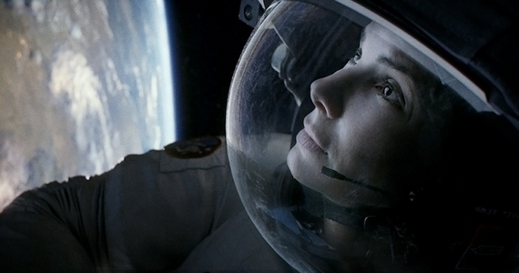 Gravity Reviews Starring George Clooney and Sandra Bullock directed by Alfonso Cuaron Gravity Review
