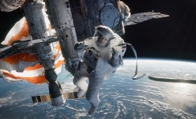 Gravity Still 4 280x170 New Gravity Images Show George Clooney and Sandra Bullock in the Ultimate Wilderness