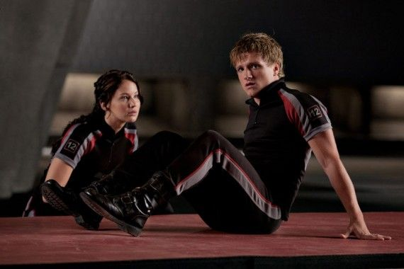 Hunger Games Katniss and Peeta Training Outfits 570x380 Hunger Games: Catching Fire Images: Katniss, Finnick, Gale, Peeta, Haymitch & More [Re Updated]