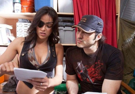 Michelle Rodriguez and Robert Rodriguez on the set of Machete Kills 570x400 Michelle Rodriguez and Robert Rodriguez on the set of Machete Kills