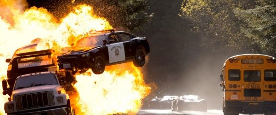 Need For Speed Movie Stunt Cop Cars Explosions 570x238 Need For Speed Interview: John Gatins Talks Story & Sequel Potential
