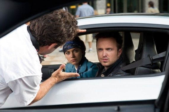 Need For Speed Official Set Photo Downtown Detroit Aaron Paul Closeup 570x380 Need For Speed Interview: John Gatins Talks Story & Sequel Potential
