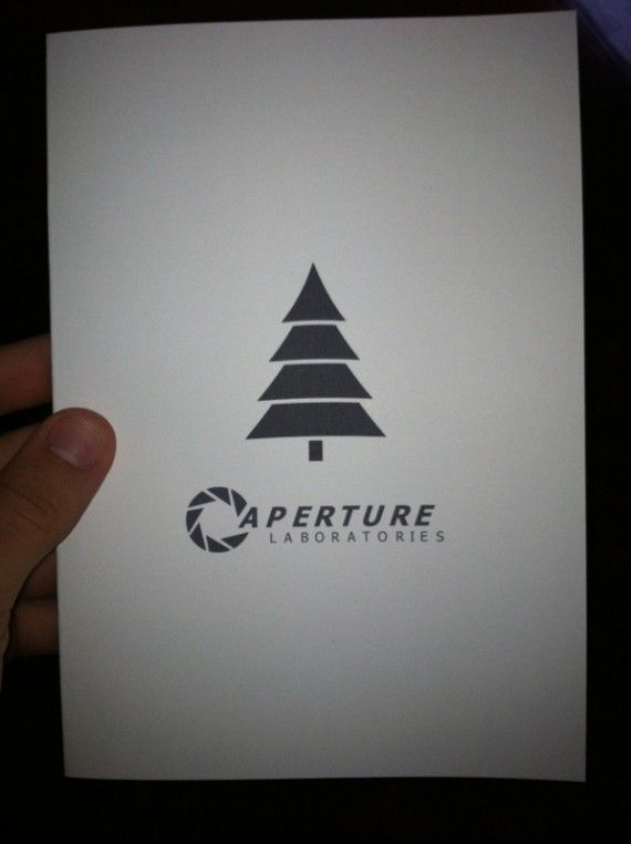 Portal Xmas Card 570x762 SR Geek Picks: Honest 2013 Oscar Movie Titles, Morgan Freeman Facts & More