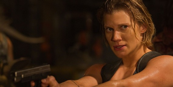 Riddick Movie Official Photo Katee Sackhoff Gun 570x288 Riddick Interview: Katee Sackhoff Talks Superhero Movie Roles & Strong Female Characters
