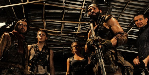 Riddick Movie Still Mercenaries 570x288 Riddick Interview: David Twohy Talks Vin Diesels Career & Franchises Future