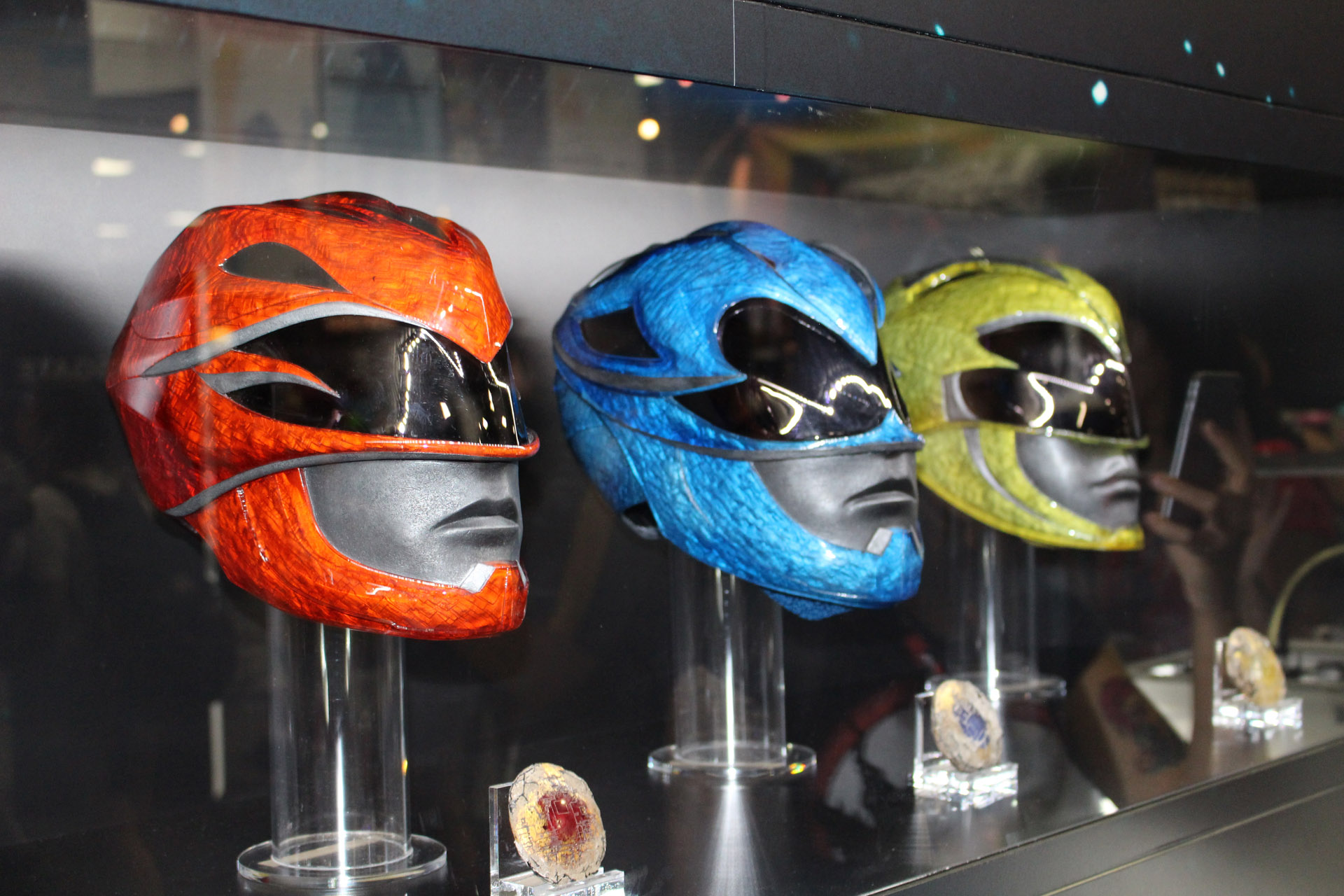 power rangers movie first look at new helmets amp power coins