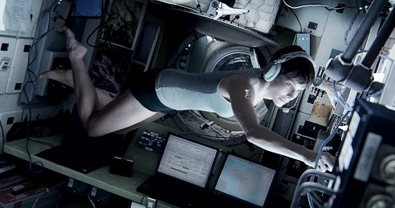 Sandra Bullock in Gravity New Gravity Images Show George Clooney and Sandra Bullock in the Ultimate Wilderness