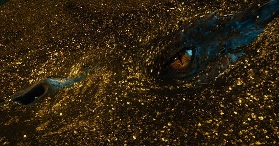 Smaug emerges from his gold in The Hobbit The Desolation of Smaug Rumor Patrol: The Hobbit 3 May Get a Different Subtitle