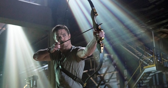 Stephen Amell taking aim in Arrow Arrow Season 2: New Gadgets, a New Villain & an Arrowcave Makeover