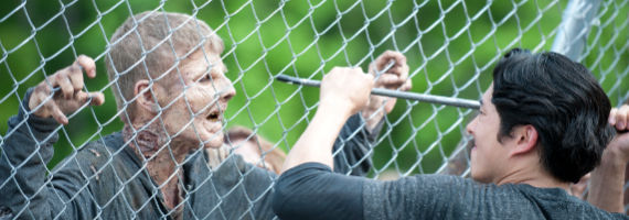 Steven Yeun and Walker in The Walking Dead Infected The Walking Dead Puts the Prison Under Siege in More Ways Than One
