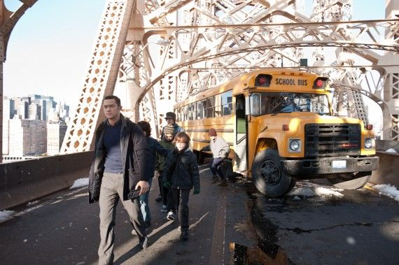 The Dark Knight Rises John Blake Joseph Gordon Levitt Evacuates School Bus 570x379 Joseph Gordon Levitt Has No Future Batman or Justice League Movie Plans (For Now)
