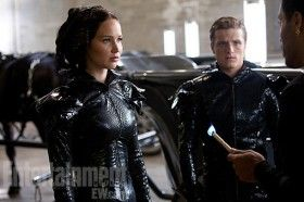 The Hunger Games Katniss Peeta Flame Costumes 280x186 New Hunger Games Image & Poster: Katniss & Peeta Get Ready to Blaze [Updated]