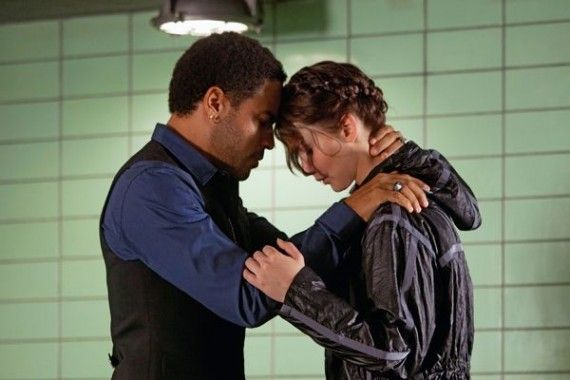 cinna katniss hunger games image 570x380 Cinna and Katniss share a tender moment in The Hunger Games