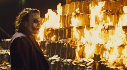 joker burning money in tdk The Dark Knight Continues Earning Insane Money
