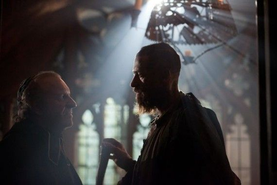 les miserables movie image hugh jackman 31 570x380 Bishop of Digne (Wilkinson) and Valjean (Jackman) in Les Misérables'