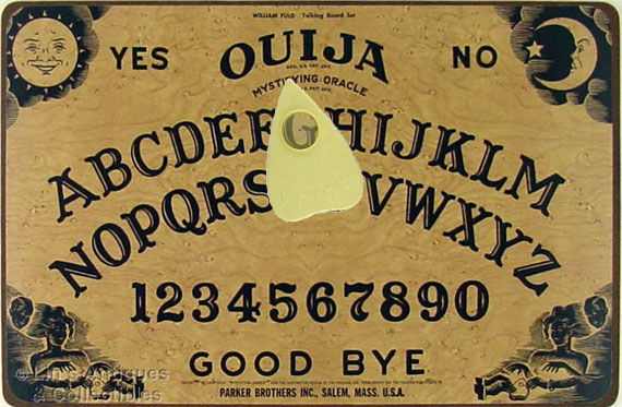 ouija board and pointer Hasbro's Ouija Board Says McG Will Be The Director