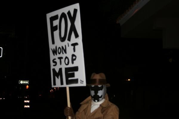 rorschach protesting Fox vs. WB: The Ultimate Watchmen Showdown