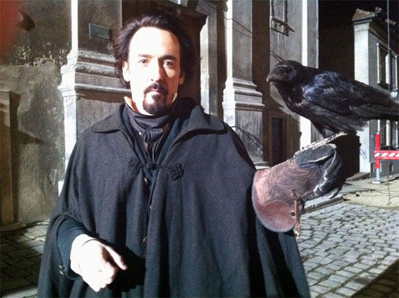 the raven john cusack edgar allan poe Movie Image Roundup: Green Lantern, Three Musketeers, Cars 2 and More [Updated]